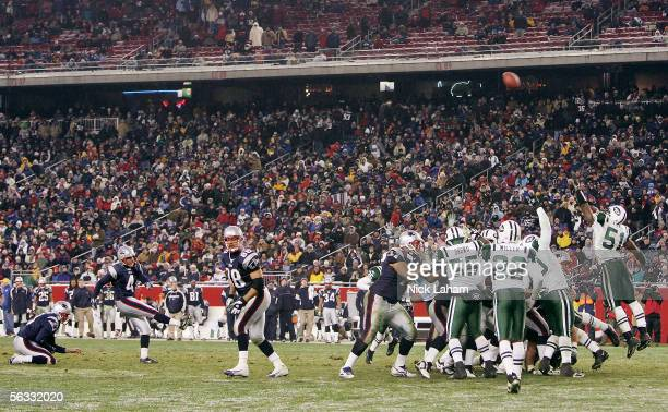 Adam Vinatieri of the New England Patriots kicks his second field goal against the New York Jets at Gillette Stadium on December 4 2005 in Foxboro...