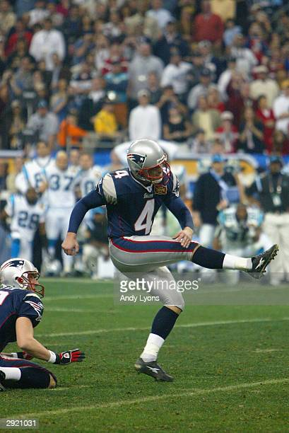 Adam Vinatieri of the New England Patriots makes the 41 yard game winning field goal defeated the Carolina Panthers 32-29 in Super Bowl XXXVIII at...