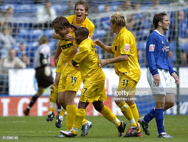 Adam Virgo of Brighton is congratulated by team amates after scoring during the CocaCola Championship match between Leicester City and Brighton and...