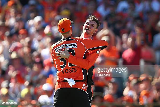Adam Voges and Ashton Turner of the Scorchers celebrate the wicket of Daniel Hughes of the Sixers during the Big Bash League match between the Perth...