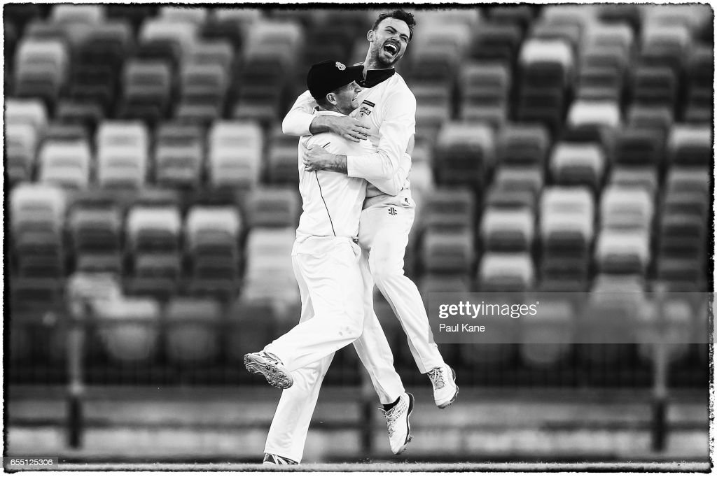 Adam Voges and Ashton Turner of Western Australia celebrate winning the Sheffield Shield match between Western Australia and New South Wales at WACA on March 19, 2017 in Perth, Australia.