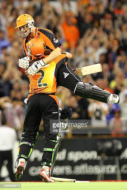 Adam Voges and Michael Hussey of the Scorchers celebrate the teams win during the Big Bash League semifinal match between the Perth Scorchers and the...