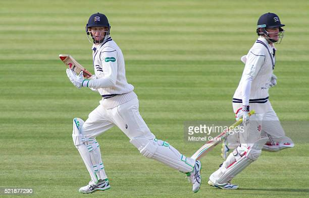 Adam Voges and Sam Robson of Middlesex run a single during the Specsavers County Championship match between Middlesex and Warwickshire at Lords...