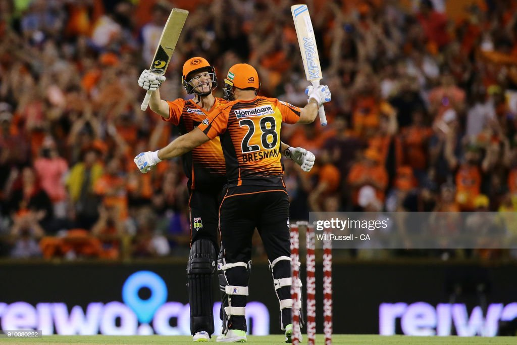 Adam Voges and Tim Bresnan of the Scorchers celebrate after defeating the Strikers during the Big Bash League match between the Perth Scorchers and the Adelaide Strikers at WACA on January 25, 2018 in Perth, Australia.