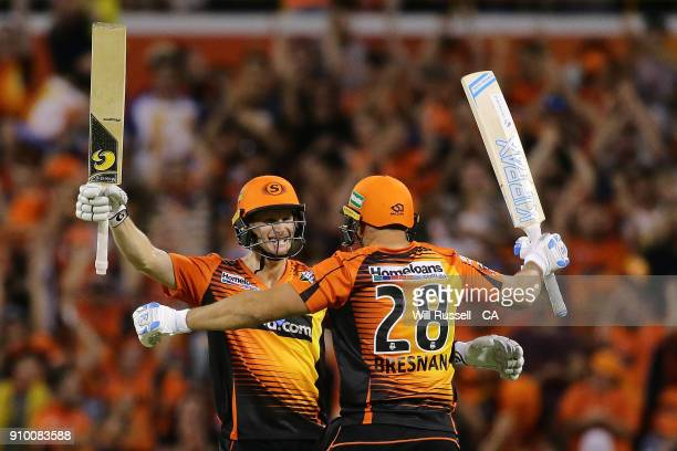 Adam Voges and Tim Bresnan of the Scorchers celebrate after defeating the Strikers during the Big Bash League match between the Perth Scorchers and...