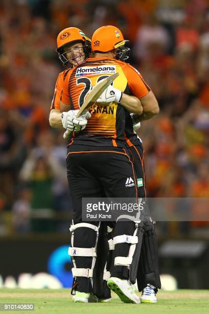 Adam Voges and Tim Bresnan of the Scorchers celebrate winning the Big Bash League match between the Perth Scorchers and the Adelaide Strikers at WACA...