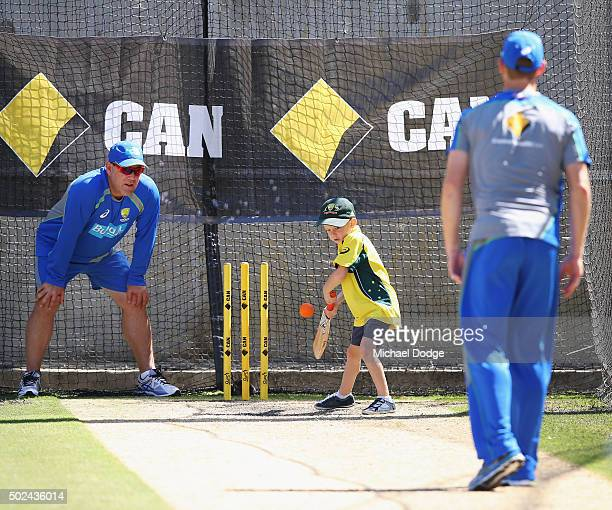 Adam Voges bowls to his son Xavier Voges as head coach Darren Lehmann fields in slips during an Australia nets session at on December 25 2015 in...