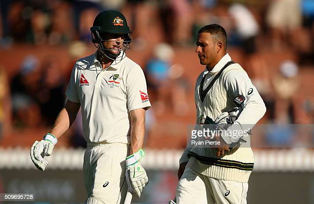 Adam Voges of Australia and Usman Khawaja of Australia walk from the ground at stumps during day one of the Test match between New Zealand and...