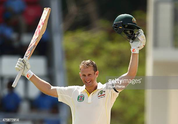 Adam Voges of Australia celebrates after reaching his maiden century in his debut test during day two of the First Test match between Australia and...