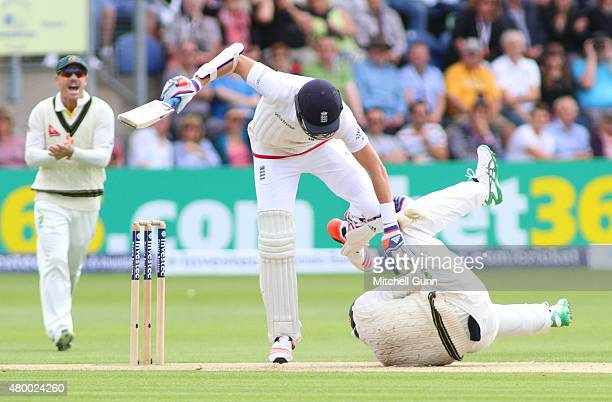 Adam Voges of Australia collides with Stuart Broad of England during day two of the 1st Investec Ashes Test match between England and Australia at...