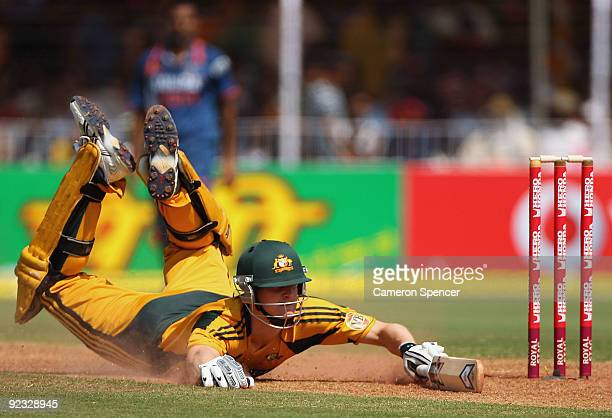 Adam Voges of Australia dives for his ground during the first One Day International match between India and Australia at Reliance Stadium on October...