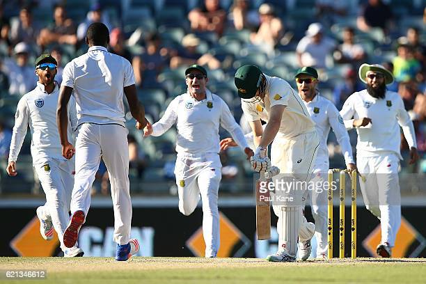Adam Voges of Australia slumps at the crease after being dismissed by Kagiso Rabada of South Africa during day four of the First Test match between...