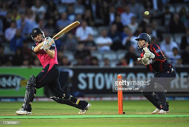 Adam Voges of Middlesex in action as James Foster of Essex watches during the Friends Life T20 match between Middlesex Panthers and Essex Eagles at...