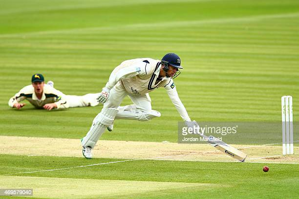 Adam Voges of Middlesex lunges for his crease as a ball by Will Gidman of Nottinghamshire narrowly misses the wickets during day two of the LV County...