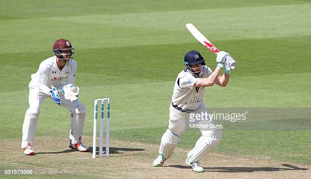 Adam Voges of Middlesex plays a shot as wicketkeeper Ben Foakes of Middlesex looks on during the Specsavers County Championship Division One match...
