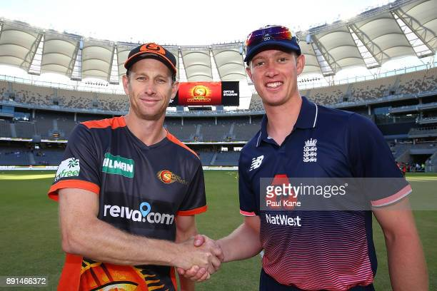 Adam Voges of the Scorchers and Keaton Jennings of the Lions shake hands following the coin toss during the Twenty20 match between the Perth...
