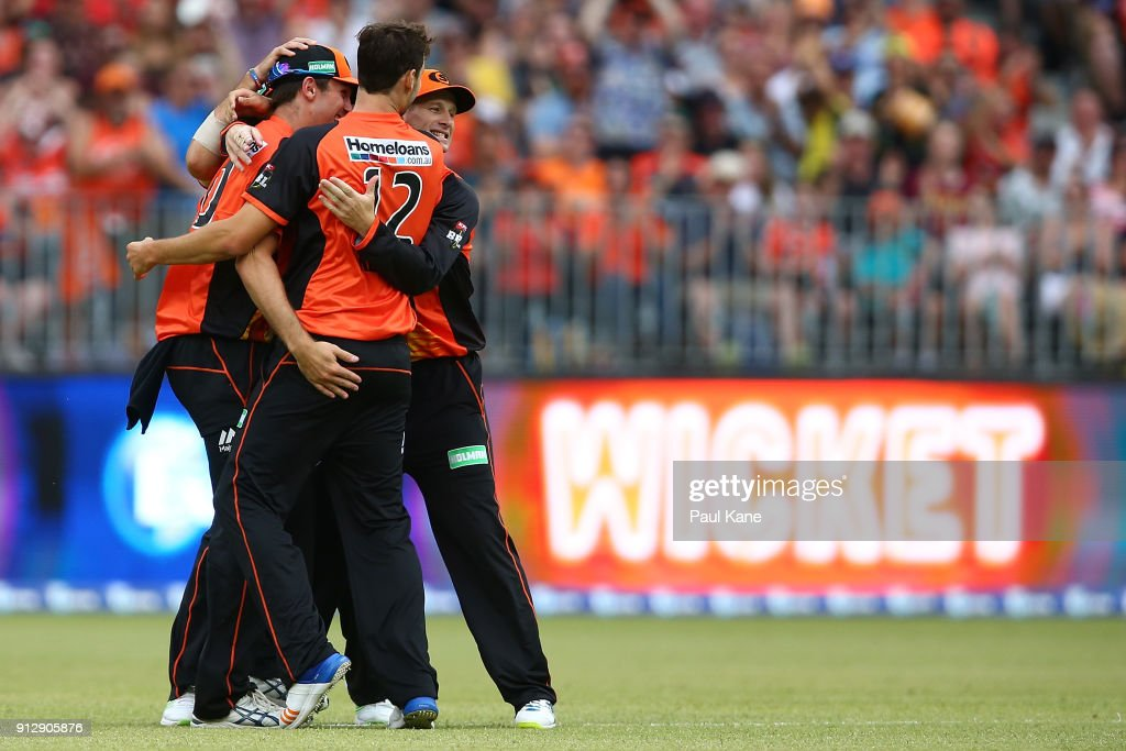 Adam Voges of the Scorchers celebrates with Matthew Kelly after the dismissal of Tim Paine of the Hurricanes during the Big Bash League Semi Final match between the Perth Scorchers and the Hobart Hurricanes at Optus Stadium on February 1, 2018 in Perth, Australia.