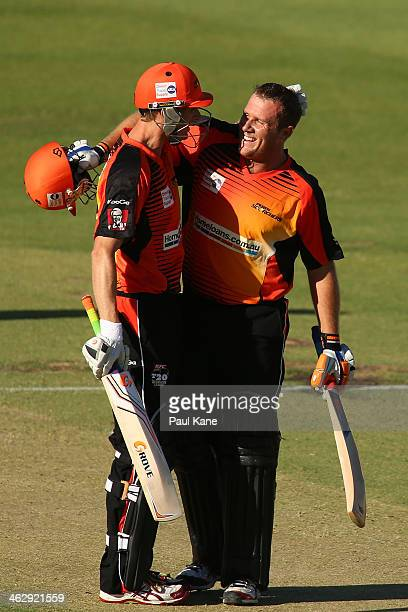 Adam Voges of the Scorchers congratulates Craig Simmons after scoring his century during the Big Bash League match between the Perth Scorchers and...