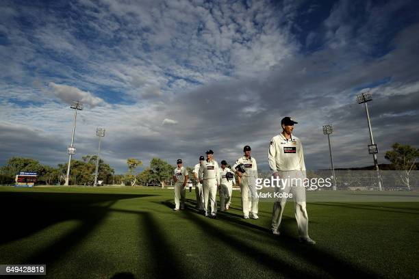 Adam Voges of the Warriors leads his team from the field at the end of play during the Sheffield Shield match between Victoria and Western Australia...