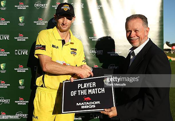 Adam Voges of the Warriors receives the man of the match award during the Matador BBQs One Day Cup match between Tasmania and Western Australia at...
