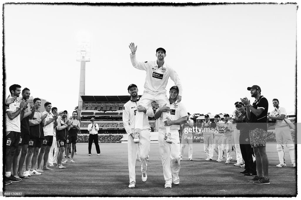 Adam Voges of Western Australia is chaired from the ground by Ashton Turner and Hilton Cartwright after playing his final state game and winning the Sheffield Shield match between Western Australia and New South Wales at WACA on March 19, 2017 in Perth, Australia.
