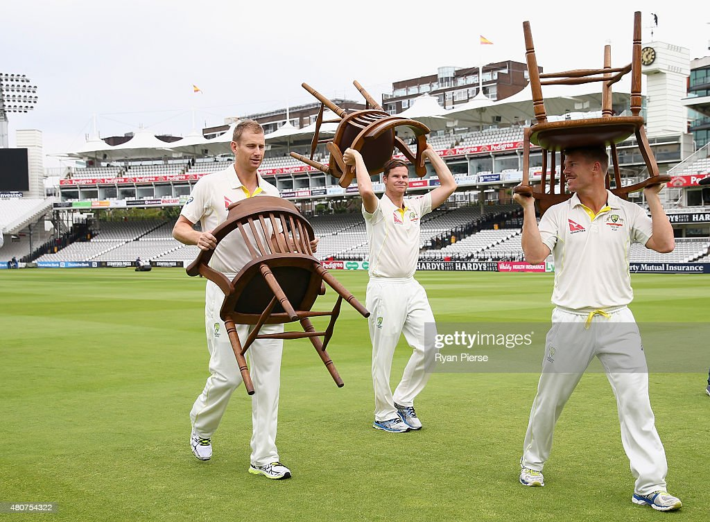 Adam Voges, Steve Smith and David Warner of Australia carry chairs after a team photo during a nets session ahead of the 2nd Investec Ashes Test match between England and Australia at Lord's Cricket Ground on July 15, 2015 in London, United Kingdom.
