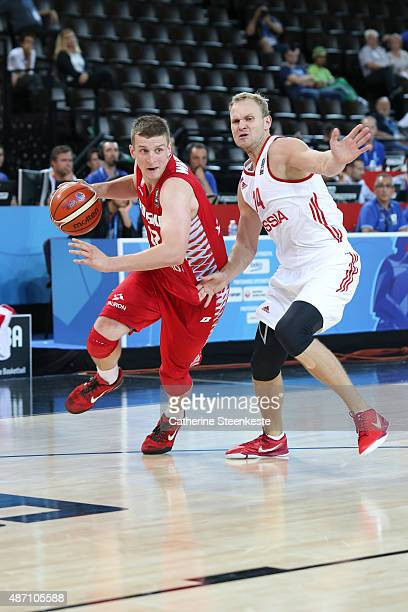 Adam Waczynski of Poland tries to drive to the basket against Anton Ponkrashov of Russia during the EuroBasket Group Phase game between Russia v...