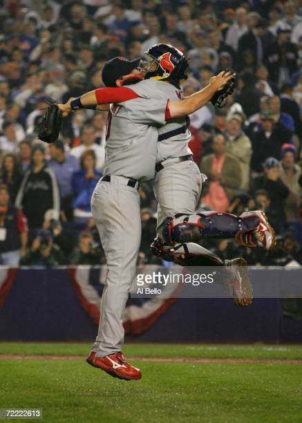 Adam Wainwright and Yadier Molina of the St Louis Cardinals celebrate after defeating the New York Mets 31 to take game seven of the NLCS at Shea...