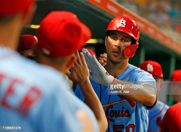 Adam Wainwright of the St. Louis Cardinals celebrates after scoring on an RBI single in the third inning against the Pittsburgh Pirates at PNC Park...