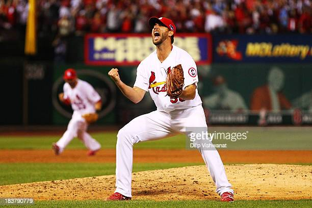 Adam Wainwright of the St Louis Cardinals celebrates defeating the Pittsburgh Pirates 6 to 1 in Game Five of the National League Division Series at...