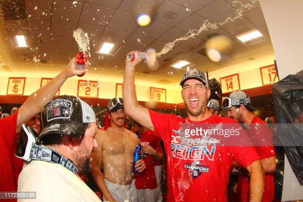 Adam Wainwright of the St. Louis Cardinals celebrates winning the National League Central Division after beating the Chicago Cubsat Busch Stadium on...
