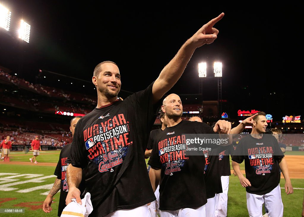 Adam Wainwright #50 of the St. Louis Cardinals celebrates with teammates after defeating the Los Angeles Dodgers in Game Four of the National League Divison Series at Busch Stadium on October 7, 2014 in St Louis, Missouri.