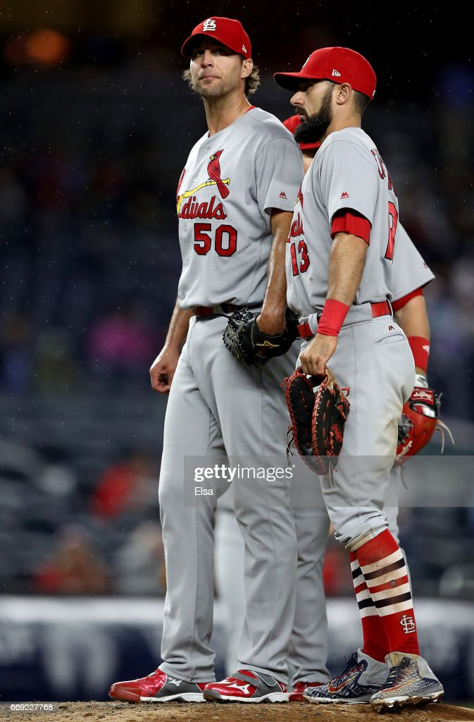 Adam Wainwright #50 of the St. Louis Cardinals is consoled by teammate Matt Carpenter #13 in the fifth inning against the New York Yankees on April 16, 2017 at Yankee Stadium in the Bronx borough of New York City.