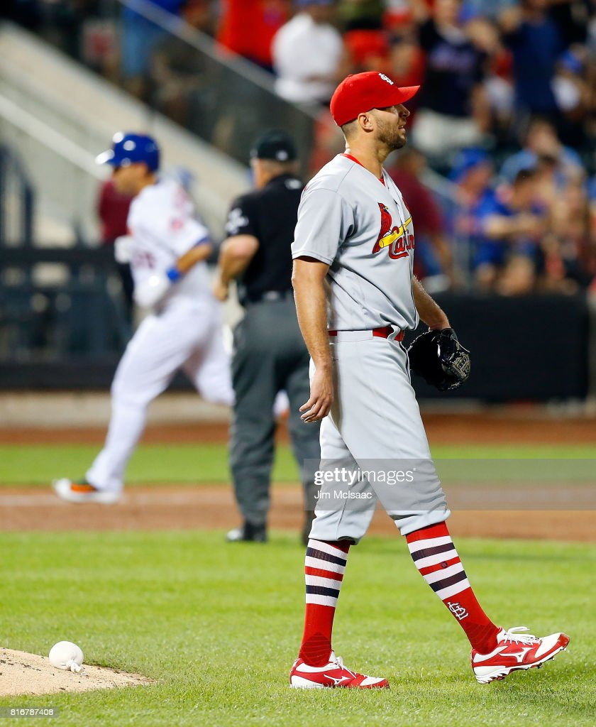 Adam Wainwright #50 of the St. Louis Cardinals looks on after surrendering a fifth inning home run against Michael Conforto #30 of the New York Mets on July 17, 2017 at Citi Field in the Flushing neighborhood of the Queens borough of New York City.