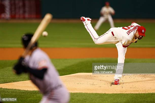 Adam Wainwright of the St. Louis Cardinals pitches in the first inning against the San Francisco Giants during Game One of the National League...