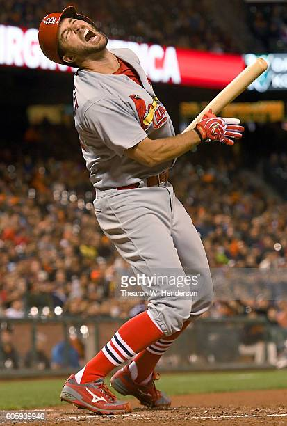 Adam Wainwright of the St Louis Cardinals reacts after hitting a popup with a runner on third base against the San Francisco Giants in the top of the...