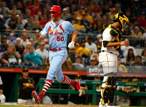 Adam Wainwright of the St. Louis Cardinals scores on an RBI single in the third inning against the Pittsburgh Pirates at PNC Park on September 7,...