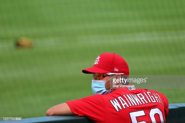 Adam Wainwright of the St. Louis Cardinals stands in the dugout prior to playing in a MLB exhibition game against the Kansas City Royals at Busch...