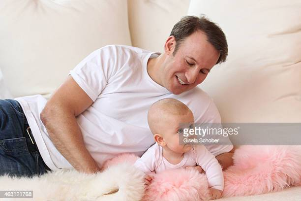 Adam Waldman and his daughter Pepper play during a portrait session at Hotel Stanglwirt on January 24 2015 in Going Austria