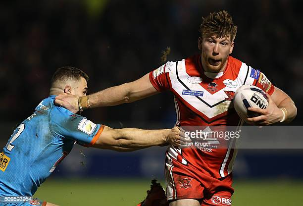Adam Walne of Salford Red Devils holds off Jack Owens of St Helens during the First Utility Super League match between Salford City Reds and St...