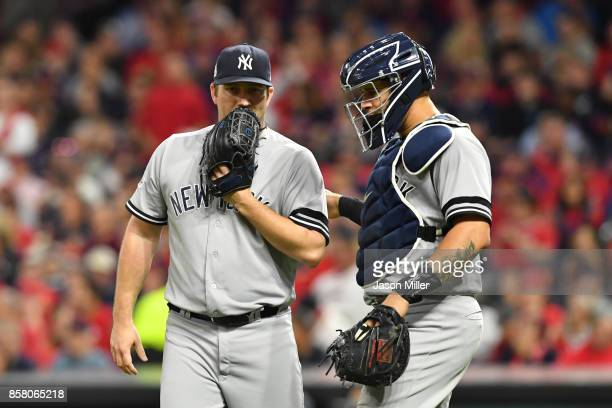 Adam Warren and Gary Sanchez of the New York Yankees discuss the signs during the fifth inning against the Cleveland Indians during game one of the...