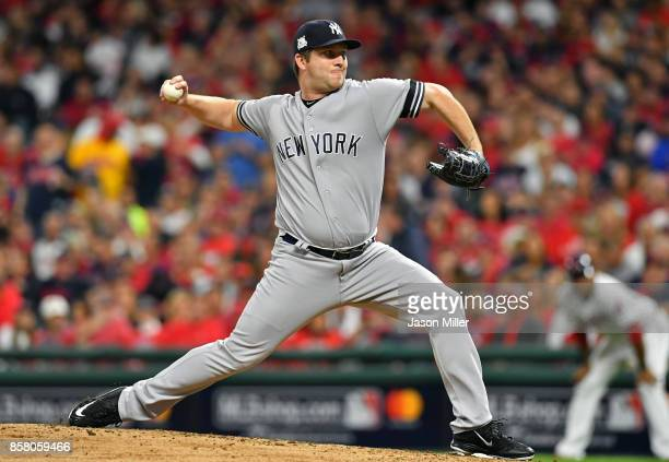 Adam Warren of the New York Yankees delivers the pitch during the fourth inning against the Cleveland Indians during game one of the American League...