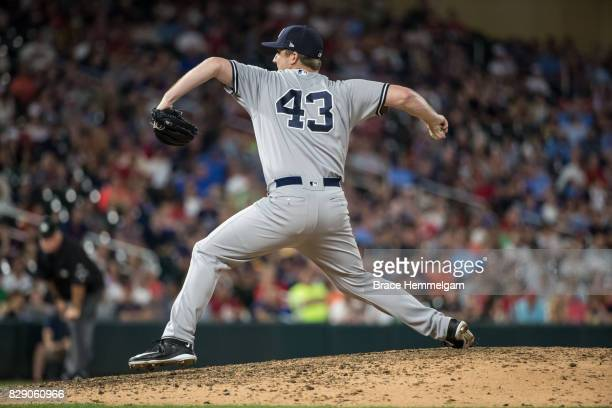Adam Warren of the New York Yankees pitches against the Minnesota Twins on July 18 2017 at Target Field in Minneapolis Minnesota The Twins defeated...