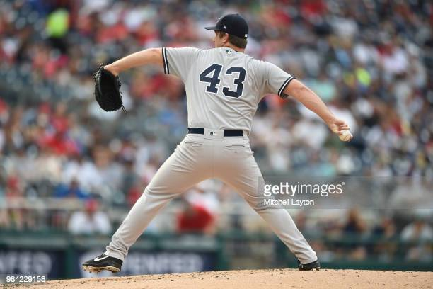Adam Warren of the New York Yankees pitches during game one of a doubleheader against the Washington Nationals at Nationals Park on June 18 2018 in...