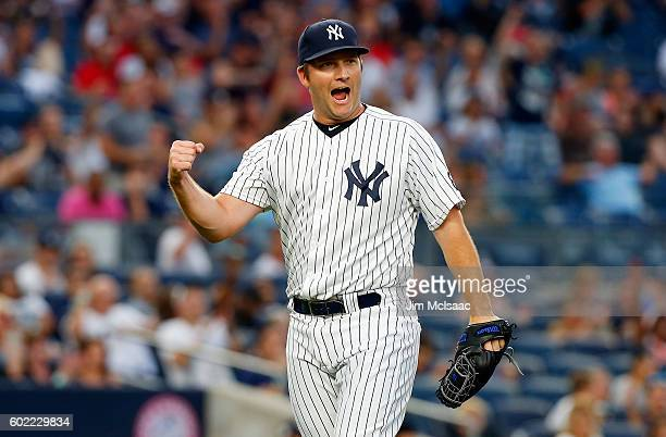 Adam Warren of the New York Yankees reacts after an eighth inning ending double play against the Tampa Bay Rays at Yankee Stadium on September 10...