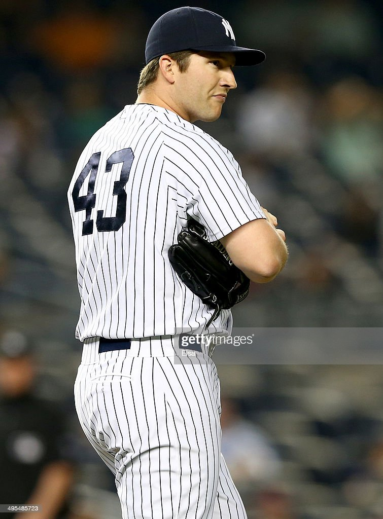 Adam Warren #43 of the New York Yankees reacts after Brandon Moss of the Oakland Athletics hit a solo home run in the 10th inning on June 3, 2014 at Yankee Stadium in the Bronx borough of New York City.