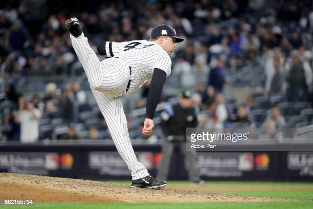 Adam Warren of the New York Yankees throws a pitch during the seventh inning against the Houston Astros in Game Three of the American League...