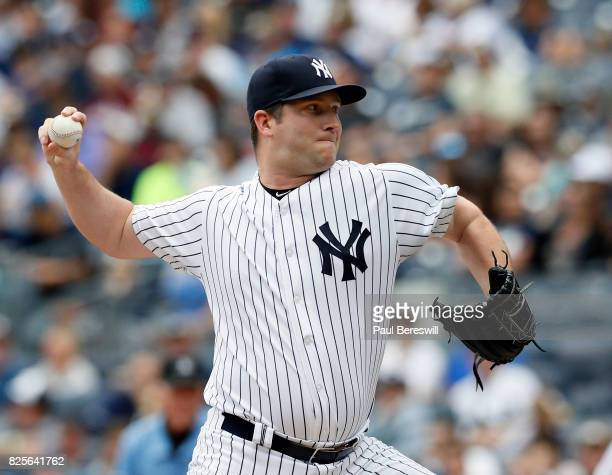 Adam Warren of the New York Yankees throws a pitch in an MLB baseball game against the Tampa Bay Rays on July 29 2017 at Yankee Stadium in the Bronx...