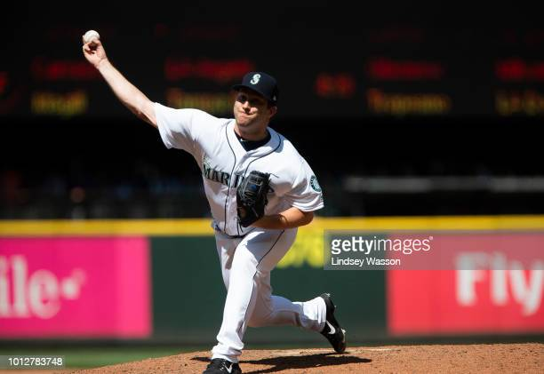 Adam Warren of the Seattle Mariners pitches against the Houston Astros during his debut with the team in the seventh inning at Safeco Field on August...