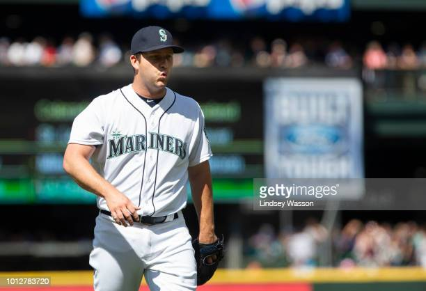 Adam Warren of the Seattle Mariners walks off the field after pitching against the Houston Astros during his debut with the team in the seventh...